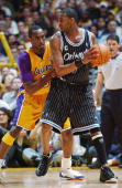 Tracy McGrady of the Orlando Magic posts up Kobe Bryant of the Los Angeles Lakers during the game at the Staples Center on March 15 2004 in Los...