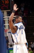 Tracy McGrady of the Orlando Magic waves to the crowd after scoring a career and franchise high 62 points against the Washington Wizards during a...