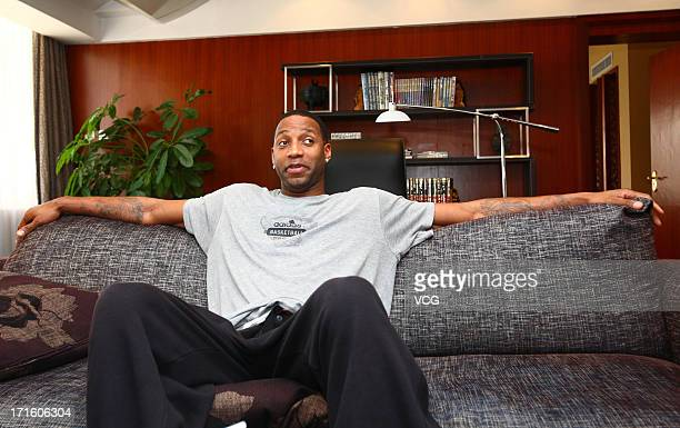 Tracy McGrady of the San Antonio Spurs attends a press conference at Nanhai Hotel on June 26 2013 in Shenzhen China