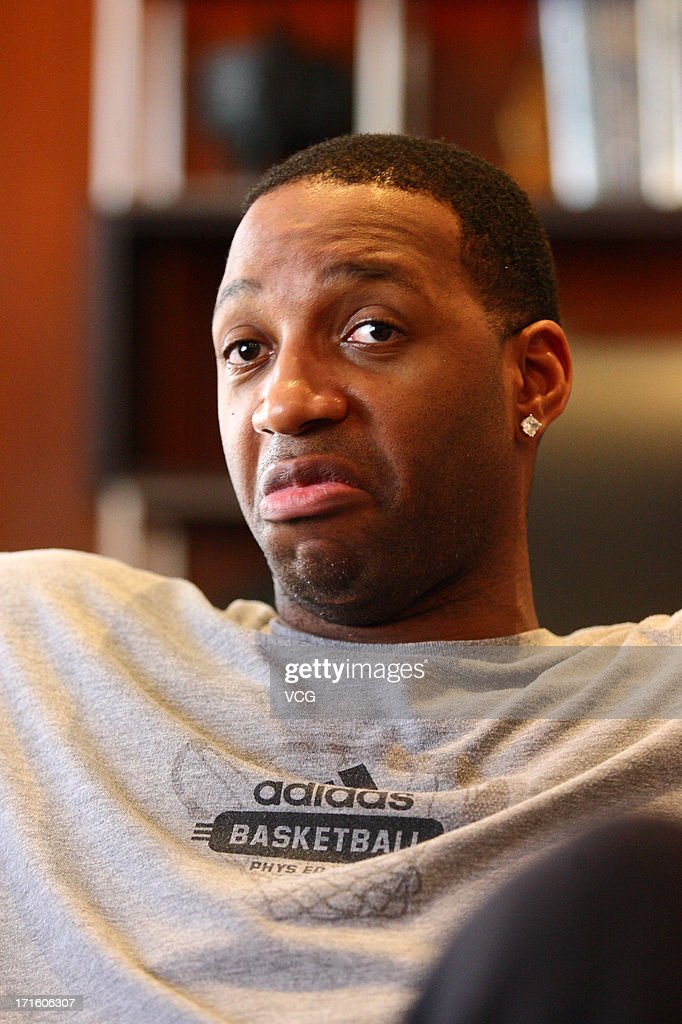 <a gi-track='captionPersonalityLinkClicked' href=/galleries/search?phrase=Tracy+McGrady&family=editorial&specificpeople=201486 ng-click='$event.stopPropagation()'>Tracy McGrady</a> of the San Antonio Spurs attends a press conference at Nanhai Hotel on June 26, 2013 in Shenzhen, China.