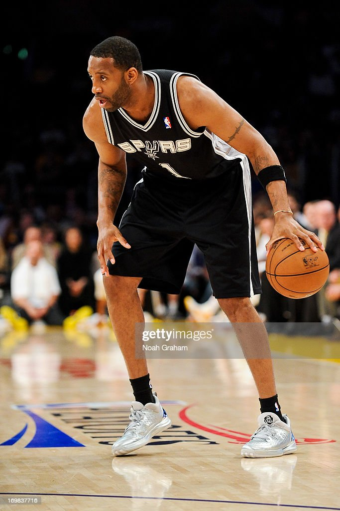<a gi-track='captionPersonalityLinkClicked' href=/galleries/search?phrase=Tracy+McGrady&family=editorial&specificpeople=201486 ng-click='$event.stopPropagation()'>Tracy McGrady</a> #1 of the San Antonio Spurs controls the ball against the Los Angeles Lakers in Game Four of the Western Conference Quarterfinals during the 2013 NBA Playoffs at Staples Center on April 28, 2013 in Los Angeles, California.