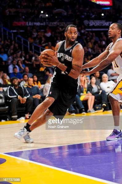 Tracy McGrady of the San Antonio Spurs drives baseline against Chris Duhon of the Los Angeles Lakers in Game Four of the Western Conference...