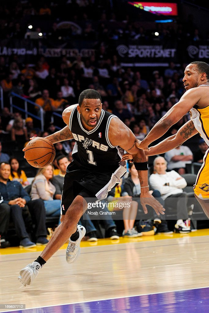Tracy McGrady #1 of the San Antonio Spurs drives the baseline against Chris Duhon #21 of the Los Angeles Lakers in Game Four of the Western Conference Quarterfinals during the 2013 NBA Playoffs at Staples Center on April 28, 2013 in Los Angeles, California.