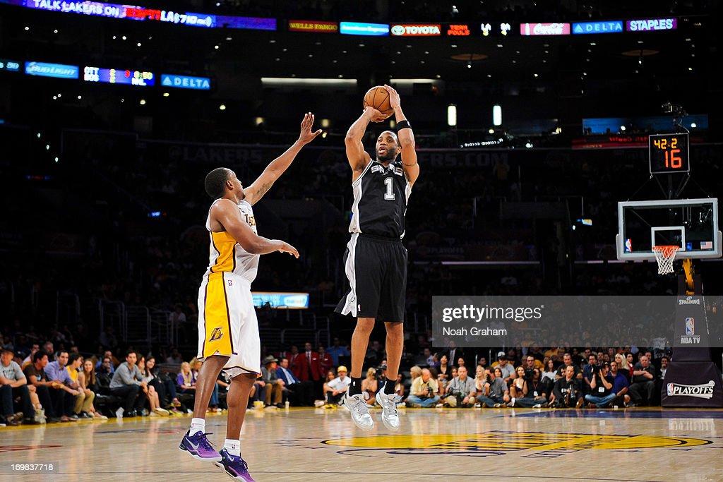 Tracy McGrady #1 of the San Antonio Spurs shoots a three-pointer against Chris Duhon #21 of the Los Angeles Lakers in Game Four of the Western Conference Quarterfinals during the 2013 NBA Playoffs at Staples Center on April 28, 2013 in Los Angeles, California.