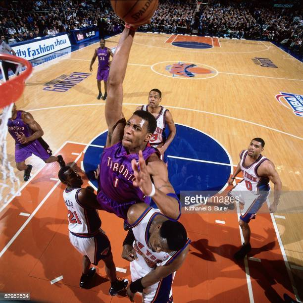 Tracy McGrady of the Toronto Raptors drives to the basket for a slam dunk against the New York Knicks during an NBA game at Madison Square Garden in...