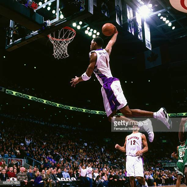 Tracy McGrady of the Toronto Raptors dunks against the Boston Celtics circa 2000 at the Air Canada Centre in Toronto Ontario NOTE TO USER User...