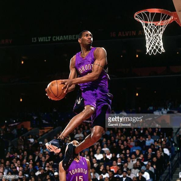 Tracy McGrady of the Toronto Raptors soars for a dunk during the 2000 NBA Slam Dunk Contest at The Arena in Oakland on February 12 2000 in Oakland...