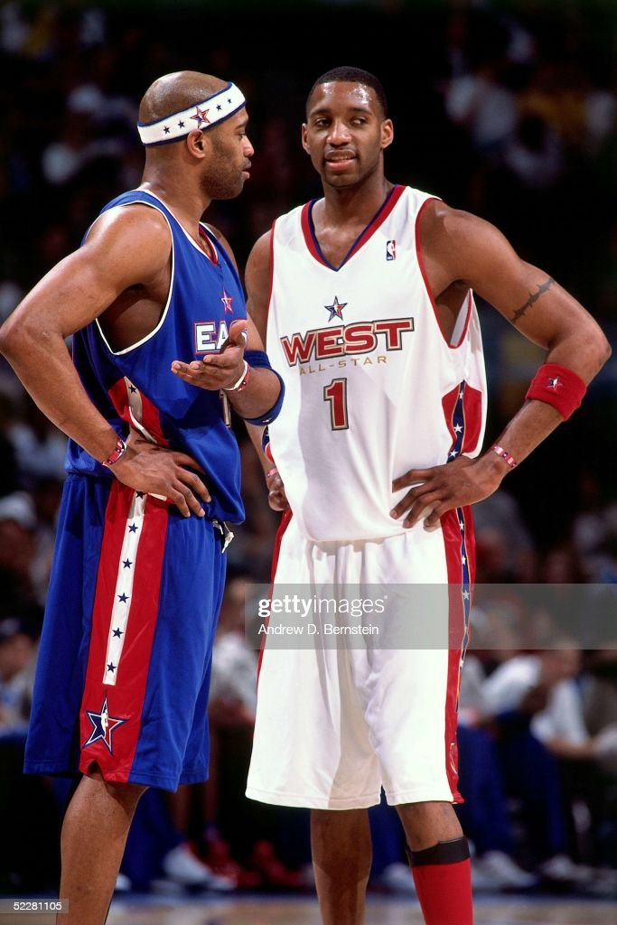 Tracy McGrady # 1 of the Western Conference All-Stars and Vince Carter #15 of the Eastern Conference All-Stars talk during the 2005 All-Star Game on February 20, 2005 at The Pepsi Center in Denver, Colorado.