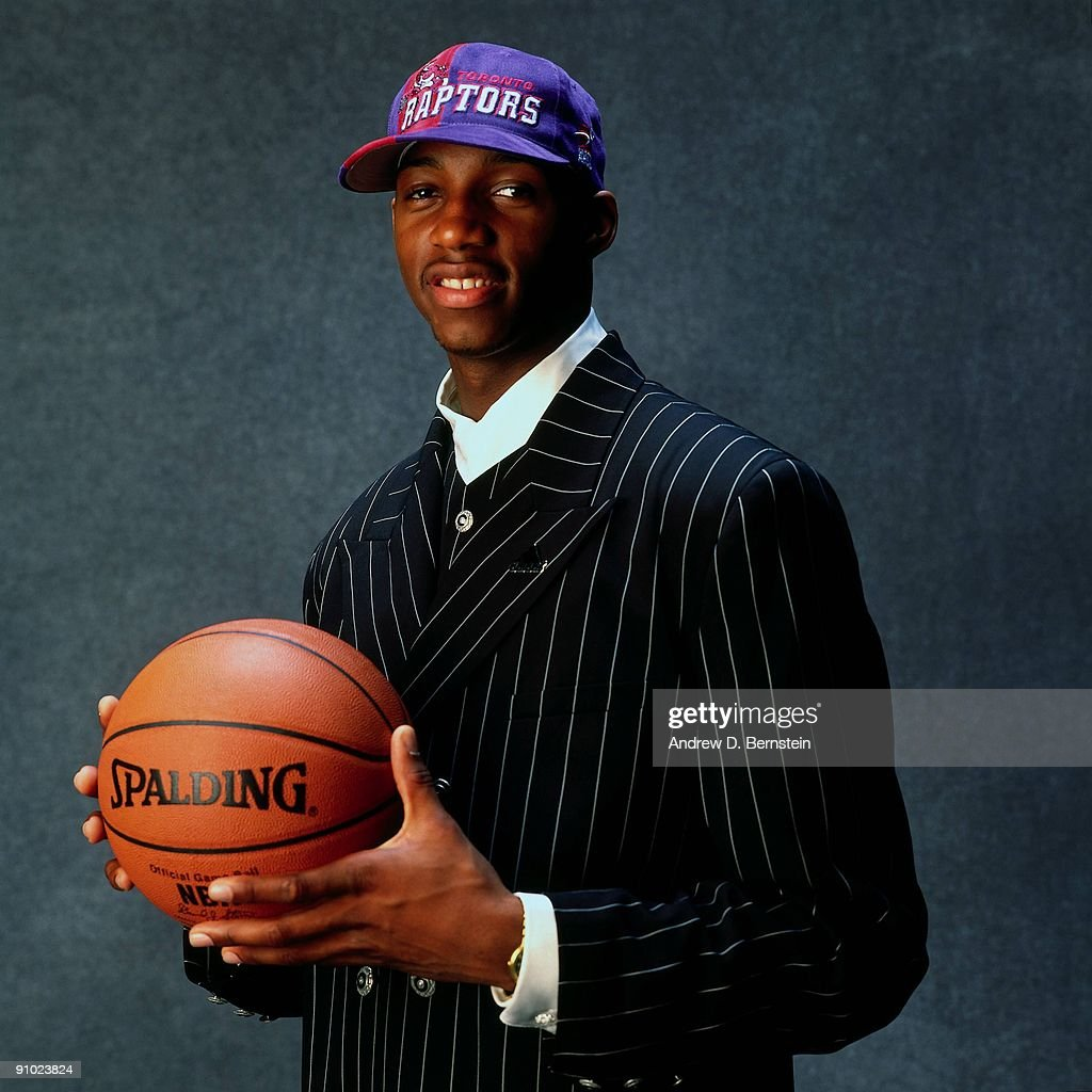 Tracy McGrady poses for a photo after being selected by the Toronto Raptors at the 1997 NBA Draft in New York, New York.