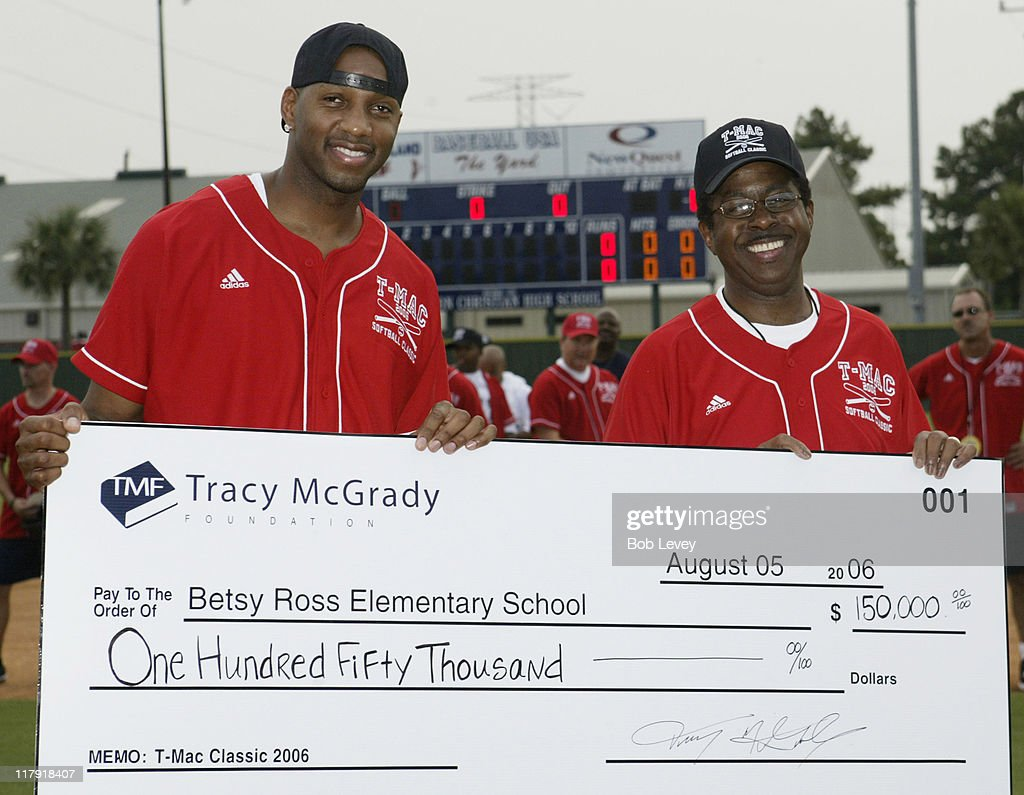 <a gi-track='captionPersonalityLinkClicked' href=/galleries/search?phrase=Tracy+McGrady&family=editorial&specificpeople=201486 ng-click='$event.stopPropagation()'>Tracy McGrady</a>,left, presents a check for $150,000.00 to the principal of Betsy Ross Elementary during the <a gi-track='captionPersonalityLinkClicked' href=/galleries/search?phrase=Tracy+McGrady&family=editorial&specificpeople=201486 ng-click='$event.stopPropagation()'>Tracy McGrady</a> Foundation 2006 Softball Classic, Aug. 5, 2006 in Houston,Tx.