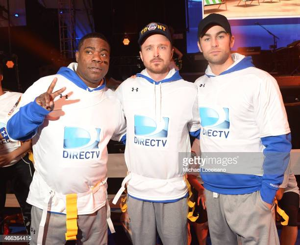 Tracy Morgan Aaron Paul and Chace Crawford participate in the DirecTV Beach Bowl at Pier 40 on February 1 2014 in New York City