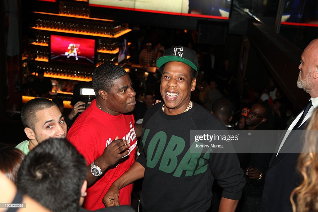 Tracy Morgan and Jay-Z attend the Premiere Of NBA 2K13 With Cover Athletes And NBA Superstars at 40 / 40 Club on September 26, 2012 in New York City.