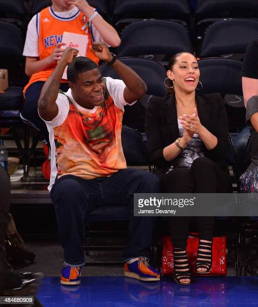 Tracy Morgan and Megan Wollover attend the Chicago Bulls vs New York Knicks game at Madison Square Garden on April 13 2014 in New York City