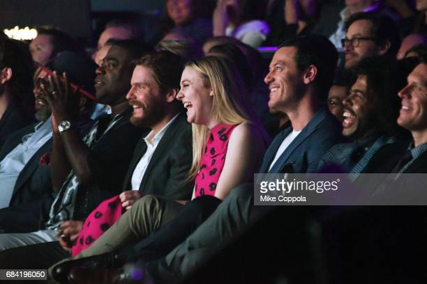 Tracy Morgan Daniel Bruhl Dakota Fanning and Luke Evans speak onstage during the Turner Upfront 2017 show at The Theater at Madison Square Garden on...