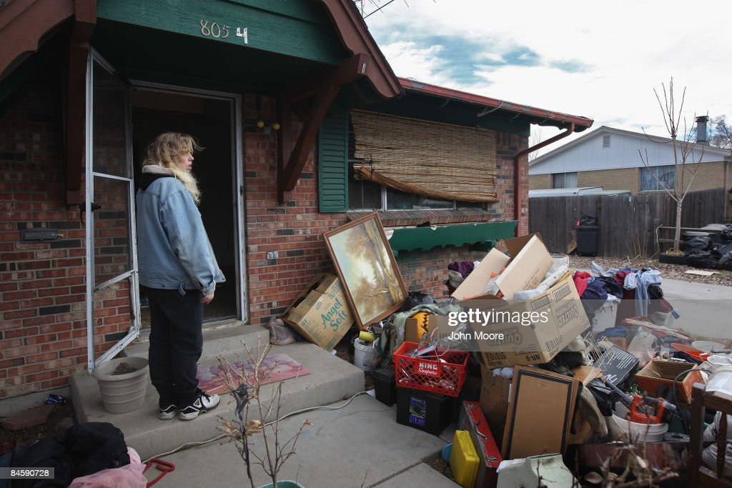 Tracy Munch looks over her belongings after an eviction team removed all of her family items from her foreclosed house on February 2, 2009 in Adams County, Colorado. Smith said she and her fiance had been renting from an owner, who collected the monthly payments but had stopped paying his mortgage. The bank foreclosed on the property and called the Adams County sheriff's department to supervise the eviction. They managed to borrow enough money to rent another house for themselves and their four children, she said, but not in time to avoid eviction.