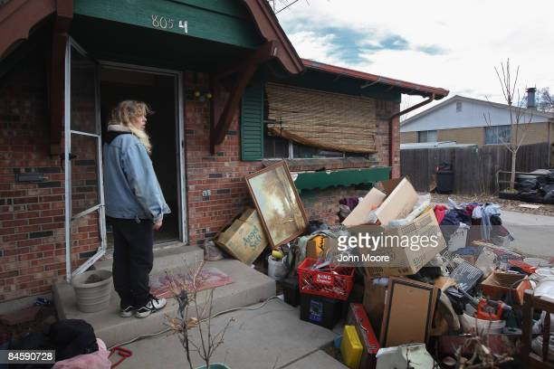 Tracy Munch looks over her belongings after an eviction team removed all of her family items from her foreclosed house on February 2 2009 in Adams...