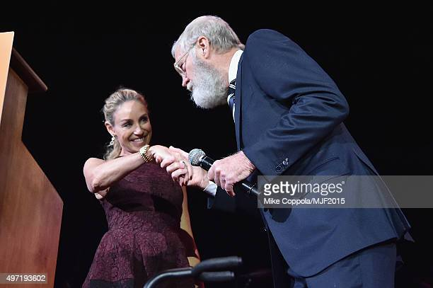"Tracy Pollan and David Letterman speak onstage during the Michael J Fox Foundation ""A Funny Thing Happened On The Way To Cure Parkinson's"" Gala at..."
