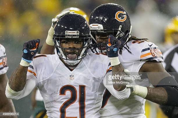 Tracy Porter of the Chicago Bears reacts after intercepting the football in the fourth quarter against the Green Bay Packers at Lambeau Field on...