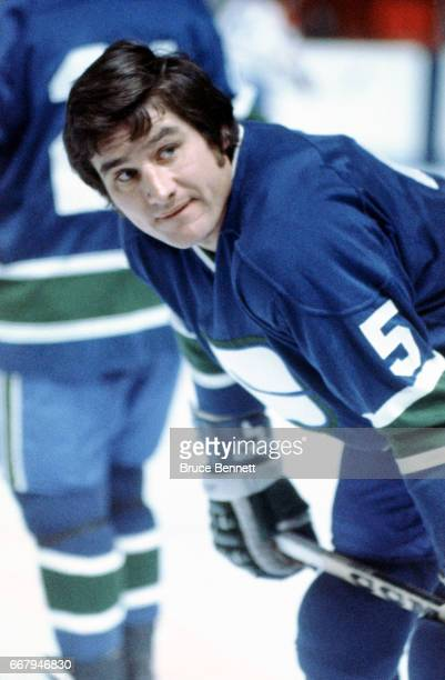 Tracy Pratt of the Vancouver Canucks skates on the ice during warmups before an NHL game against the Montreal Canadiens circa 1976 at the Montreal...