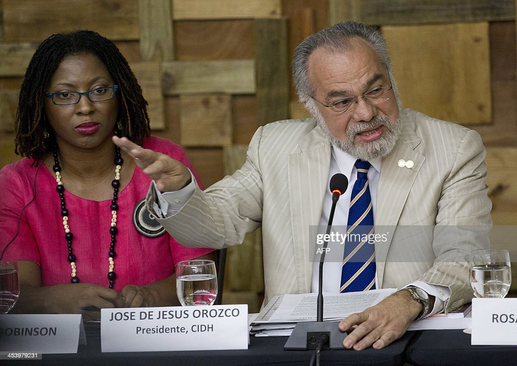 Tracy Robinson (L), first vice president and Jose de Jesus Orozco, president of the Inter American Commission of Human Rights (IACHR), give in a press conference in Santo Domingo, on December 6, 2013. The IACHR visit comes after the Constitutional Court of the Dominican Republic on September stripped from their citizenship more than 250,000 Dominican-born offspring of undocumented Haitians. AFP PHOTO / Erika SANTELICES