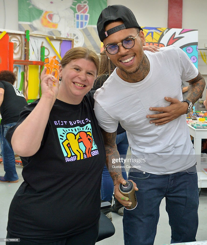 Tracy Seaton and Chris Brown attend the Chris Brown joins forces with artist Romero Britto in support of Best Buddies International event on March 27, 2013 in Miami, Florida.