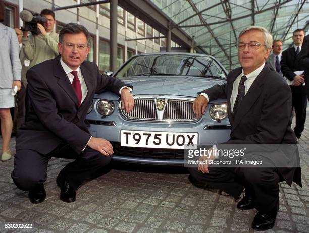 Trade and Industry Secretary Stephen Byers left with BMW chairman Professor Joachim Milberg outside the Department of Trade and Industry in London...