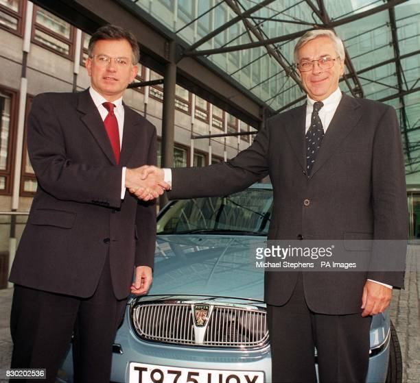 Trade and Industry Secretary Stephen Byers with BMW chairman Professor Joachim Milberg outside the Department of Trade and Industry in London with a...
