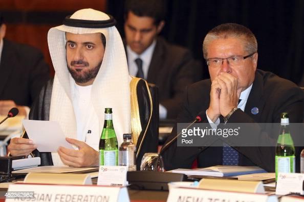 Trade Ministers of the Russian Federation Alexey Ulyukaev right and Saudi Arabia Tawfig bin Fouzan AlRabiah listen to Australia's Minister for Trade...