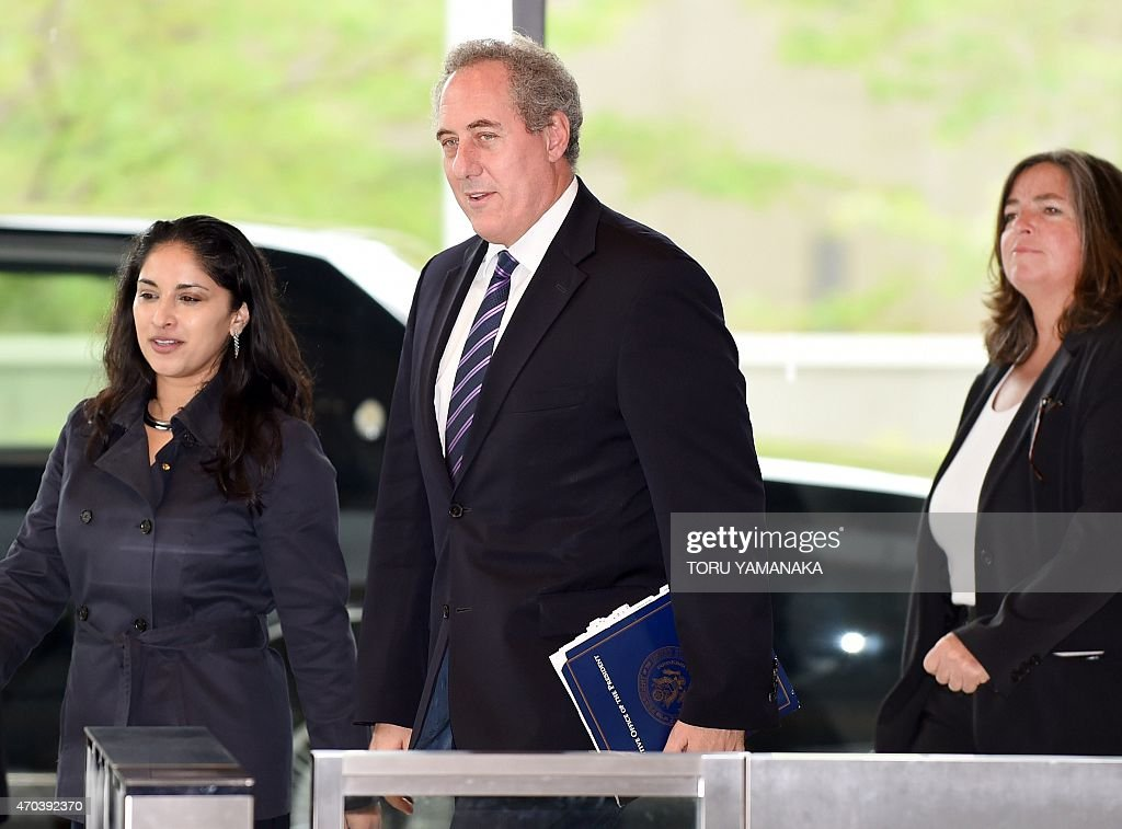 US Trade Representative <a gi-track='captionPersonalityLinkClicked' href=/galleries/search?phrase=Michael+Froman&family=editorial&specificpeople=5935975 ng-click='$event.stopPropagation()'>Michael Froman</a> (C) arrives at a Japanese government building to talk with his Japanese counterpart over deadlocked Trans-Pacific Partnership (TPP) negotiations in Tokyo on April 20, 2015. The Trans-Pacific Partnership is a trade framework negotiated between Australia, Brunei, Canada, Chile, Japan, Malaysia, Mexico, New Zealand, Peru, Singapore, the United States and Vietnam. AFP PHOTO / Toru YAMANAKA