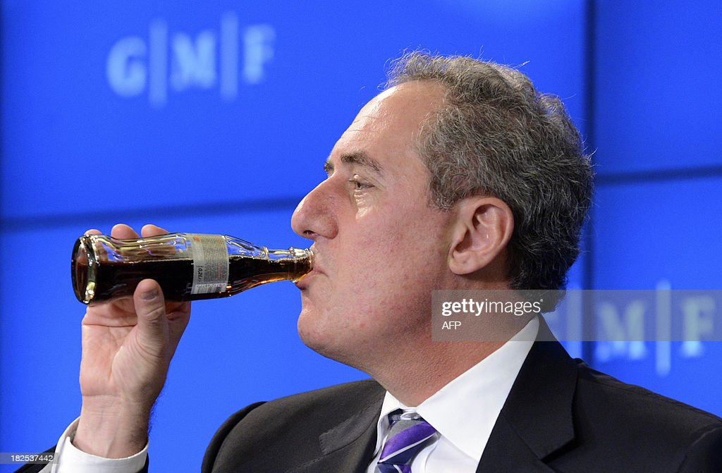 US trade representative Michael Froman drinks a soda as he takes part in a conference of the German Marshall Fund of the US at the Residence Palace in Brussels son September 30, 2013. AFP PHOTO / Thierry Charlier