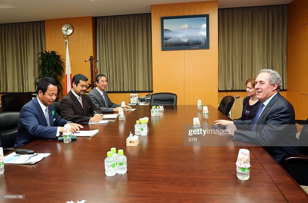 US Trade Representative <a gi-track='captionPersonalityLinkClicked' href=/galleries/search?phrase=Michael+Froman&family=editorial&specificpeople=5935975 ng-click='$event.stopPropagation()'>Michael Froman</a> (R) speaks with his Japanese counterpart <a gi-track='captionPersonalityLinkClicked' href=/galleries/search?phrase=Akira+Amari&family=editorial&specificpeople=3868034 ng-click='$event.stopPropagation()'>Akira Amari</a> (L) at talks over deadlocked Trans-Pacific Partnership (TPP) negotiations, at Amari's office in Tokyo on April 19, 2015. The Trans-Pacific Partnership is a trade framework negotiated between Australia, Brunei, Canada, Chile, Japan, Malaysia, Mexico, New Zealand, Peru, Singapore, the United States and Vietnam.