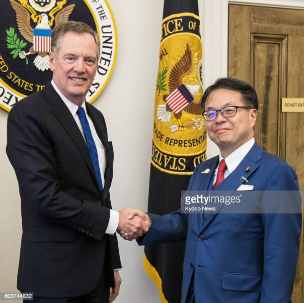 US Trade Representative Robert Lighthizer and Japanese Economy Trade and Industry Minister Hiroshige Seko shake hands before their talks in...