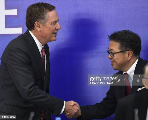 US Trade Representative Robert Lighthizer shakes hands with Japan's Minister of Trade and Industry Hiroshige Seko prior to a joint press conference...