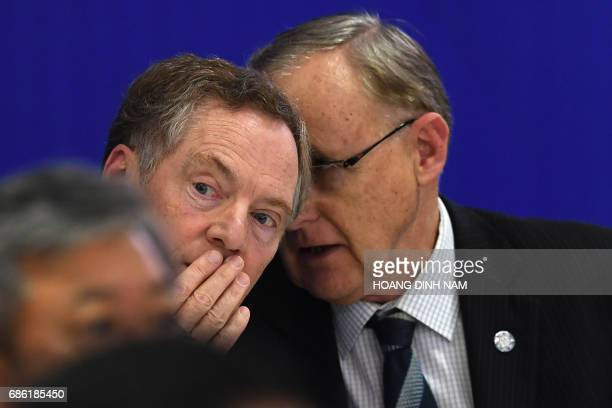 US Trade Representative Robert Lighthizer speaks with an unidentified APEC Secretariat official during a joint press conference held on the sidelines...