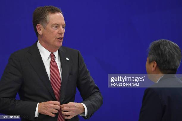 US Trade Representative Robert Lighthizer speaks with an unidentified delegate from the South Korean delegation at the end of a joint press...