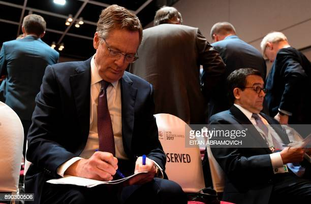 US Trade Representative Robert Lighthizer speaks with Mexican Economy Minister Ildefonso Guajardo before the 11th Ministerial Conference of the World...