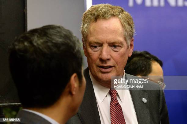 US Trade Representative Robert Lighthizer speaks with Vietnam's Minister of Trade and Industry Tran Tuan Anh at the end of a joint press conference...