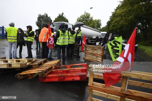 Trade union members and truckers block a traffic circle near a refinery on September 25 2017 in VernsurSeiche western France to protest against...