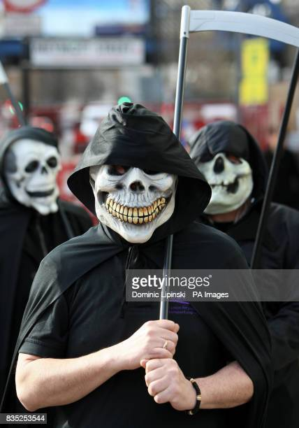 TSSA trade union members dressed as the grim reaper demonstrate outside the headquarters of Southeastern Trains in Southwark London to urge company...