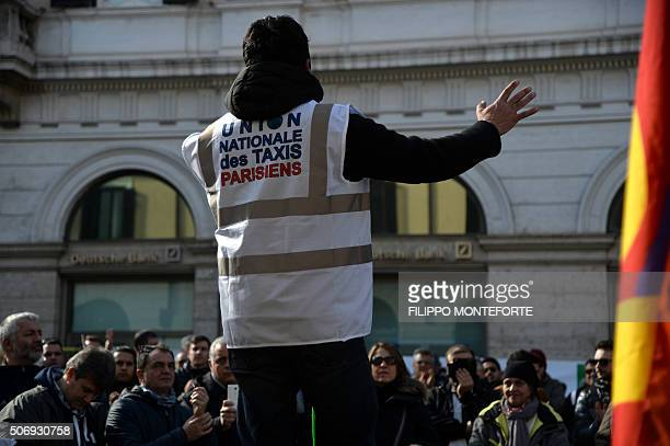 A trade union rapresentative wears the Parisian taxi drivers union jersey as taxi drivers protest in downtown Rome Piazza Santi Apostoli on January...