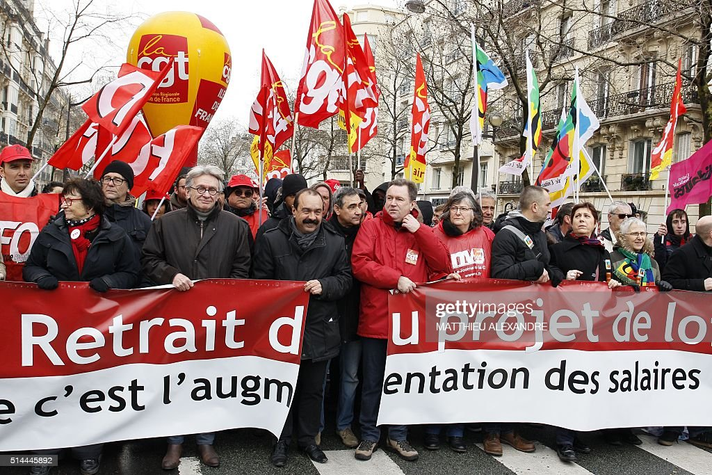 CGT trade union Secretary General Philippe Martinez and FO union federation Secretary General JeanClaude Mailly take part in a demonstration in Paris...