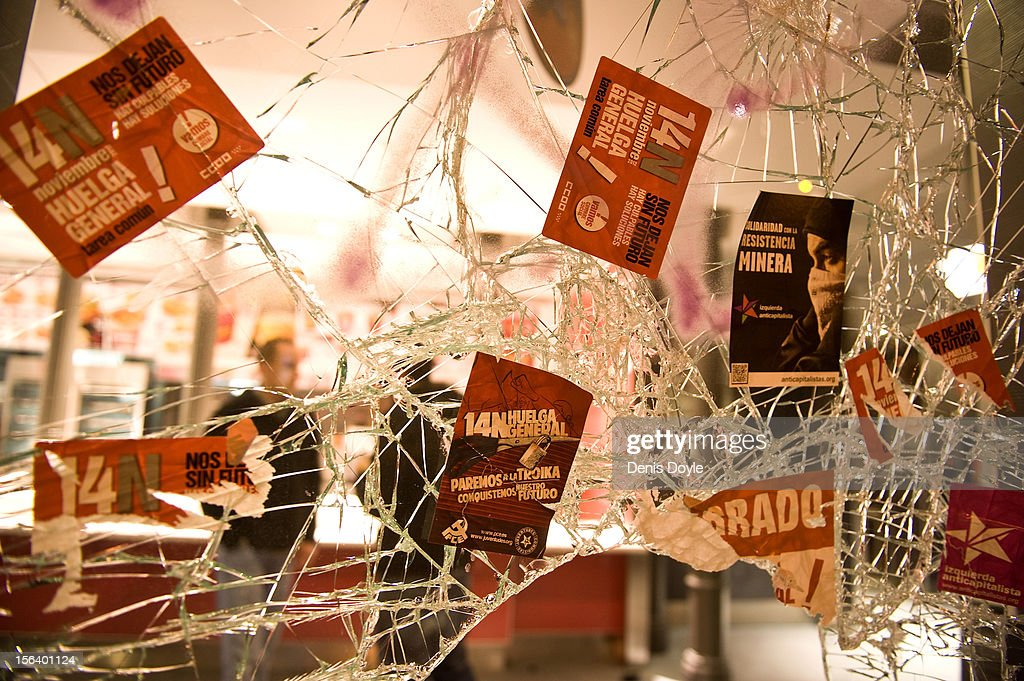 Trade union stickers are stuck to the broken glass window of a restaurant after a demonstration near the Spanish parliament turned violent on November 14, 2012 in Madrid, Spain. A coordinated general strike by unions in Spain and Portugal has paralysed public transport in the two countries with further strikes planned across Europe. The strike against the governments' austerity measures have force hundreds of flights to be cancelled and factories and ports to come to a standstill.