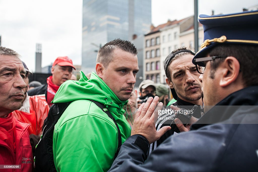 Trade unionists negotiate with the police, as an anti government protest ended up in a riot in Brussels on May 24, 2016.