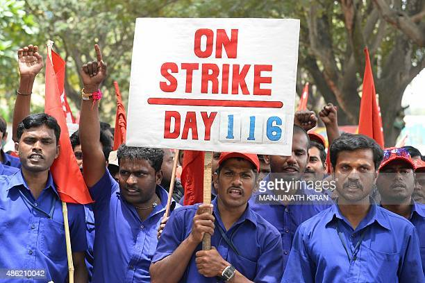 Trade unions activists shout slogans during a protest rally called by Centre of India Trade Unions against the central government's economic policies...
