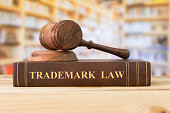 Trademark law books and a judge gavel on desk in the library. concept of legal education.'n