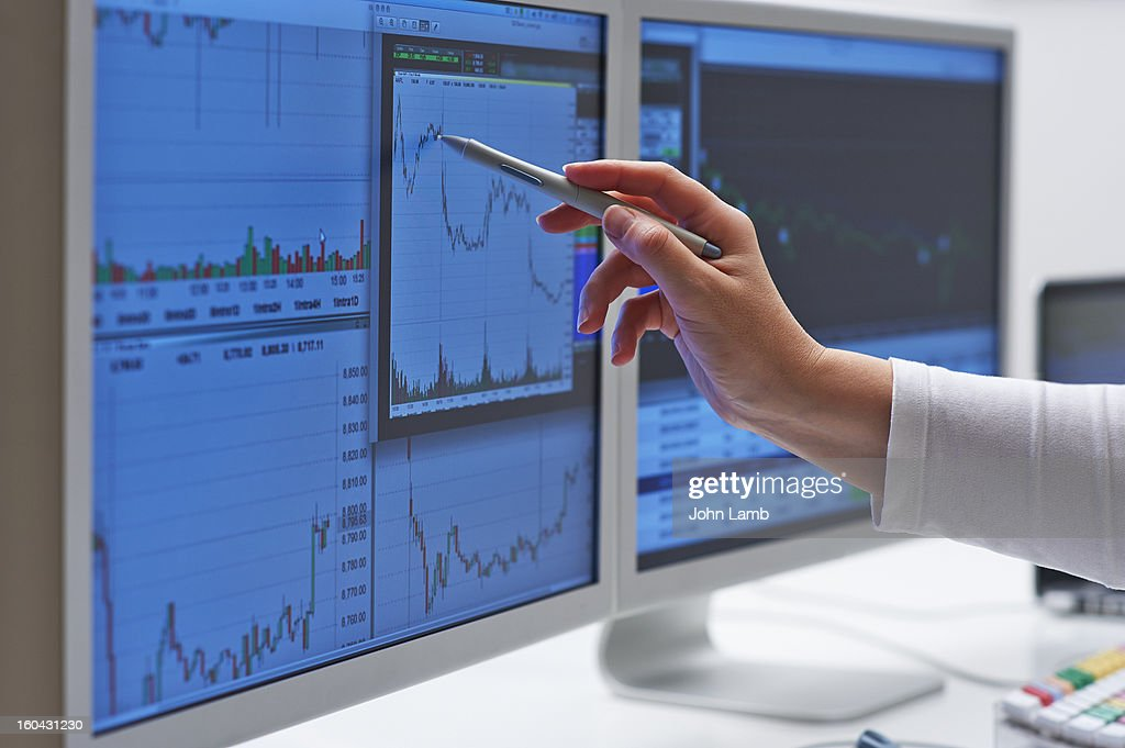 Trader analysis : Stock Photo