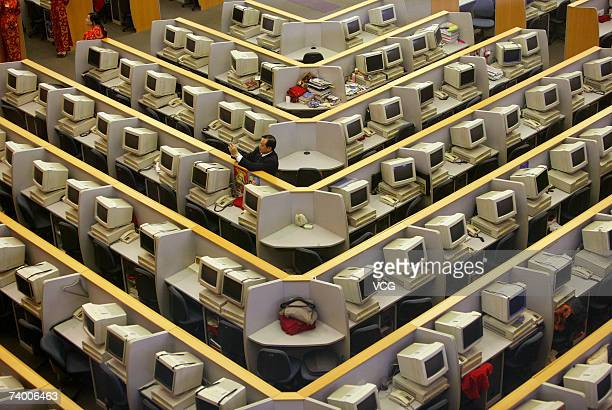 A trader attends the IPO of China CITIC bank at the Shanghai Stock Exchange room on April 27 2007 in Shanghai China Shares in China CITIC Bank Corp...