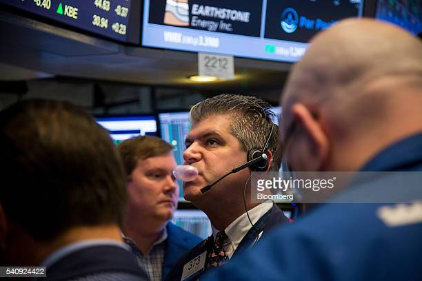 A trader blows a bubble while chewing gum on the floor of the New York Stock Exchange in New York US on Friday June 17 2016 US stocks retreated...