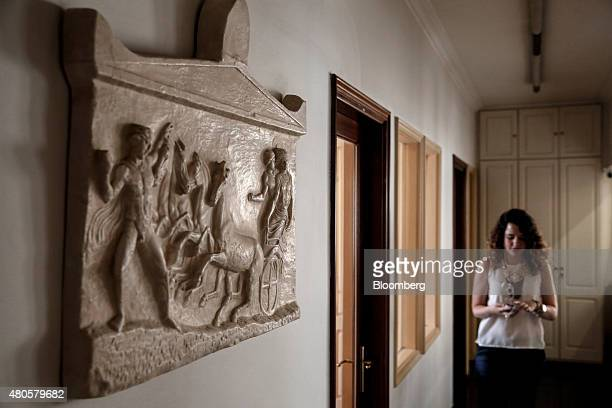 A trader checks her mobile phone in a corridor inside the offices of Nuntius Securities SA brokers in Athens Greece on Monday July 13 2015 Greece has...