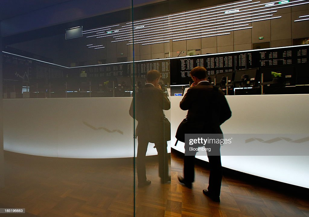 A trader enters the trading floor at the Frankfurt Stock Exchange in Frankfurt, Germany, on Friday, Oct. 18, 2013. Global stocks rose for a third day, extending a five-year high, and copper climbed after China's economic growth quickened. Photographer: Ralph Orlowski/Bloomberg via Getty Images